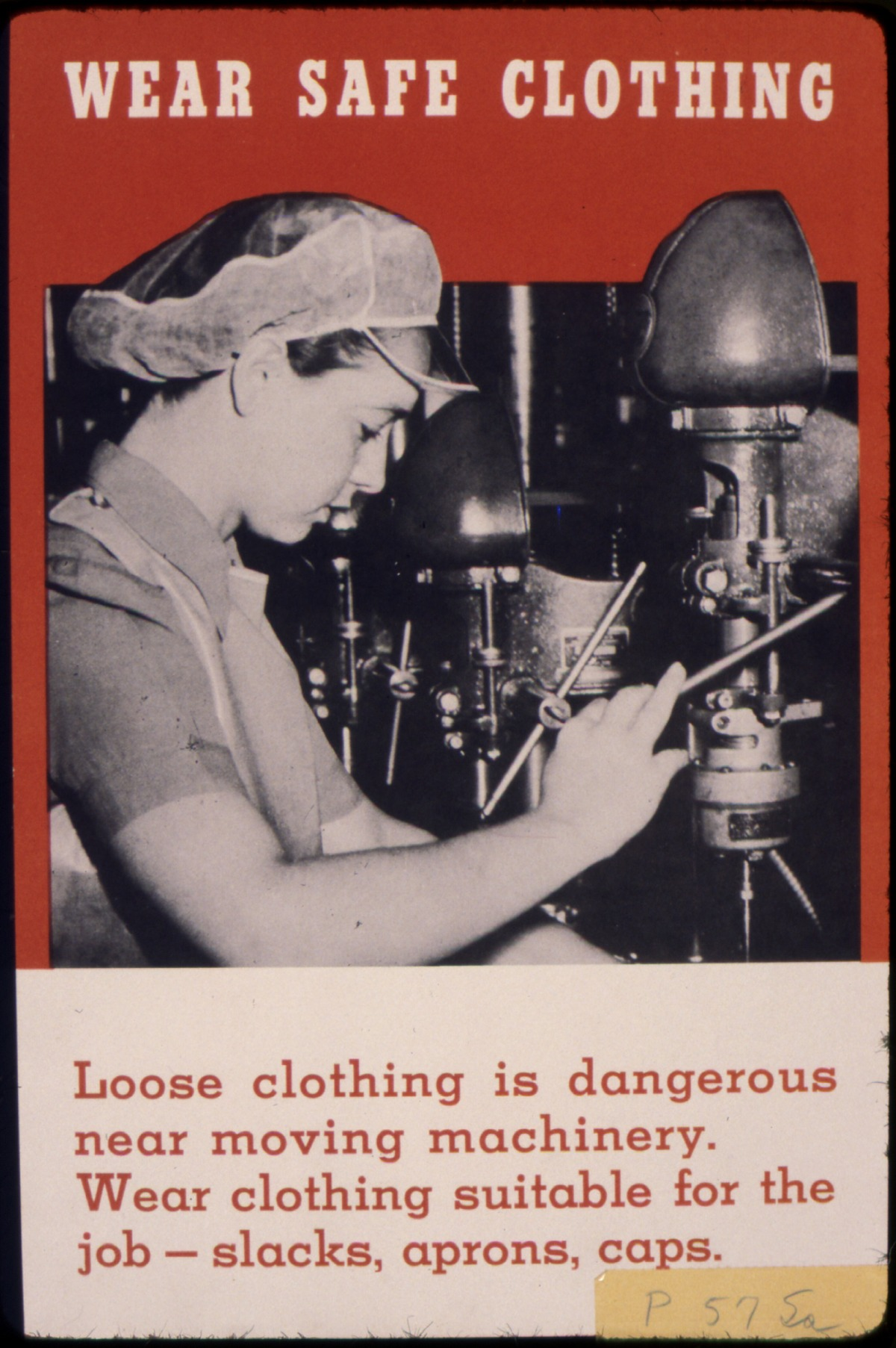 Wear_safe_clothing._Loose_clothing_is_dangerous_near_moving_machinery._Wear_clothing_suitable_for_the_job_-_slacks..._-_NARA_-_535279